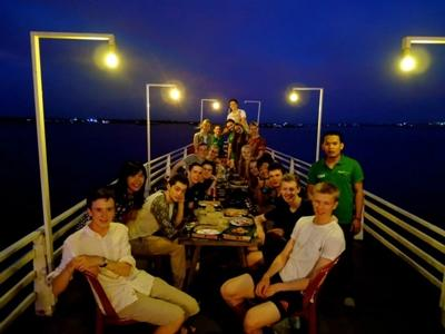 A group of Projects Abroad volunteers enjoy a local meal during free time in Cambodia