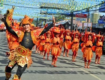 Locals perform at the Sinulog festival in the Philippines
