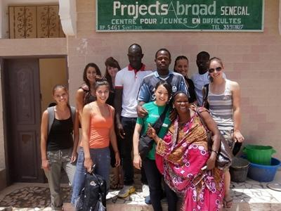 Volunteers and staff outside a Senegalese care facility for children.