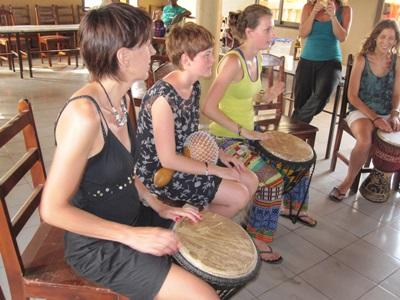 Volunteers practice drumming on the performing arts project in Togo with Projects Abroad
