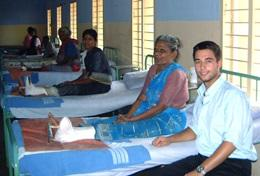 A medical student visits a patient recovery ward during his elective placement in India